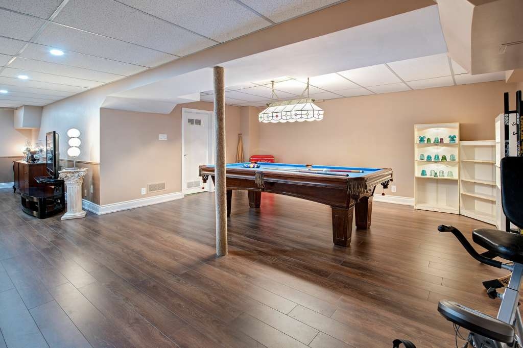 finished basement with a pool table